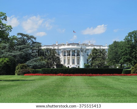 The White House in Washington, DC with blue sky background - stock photo