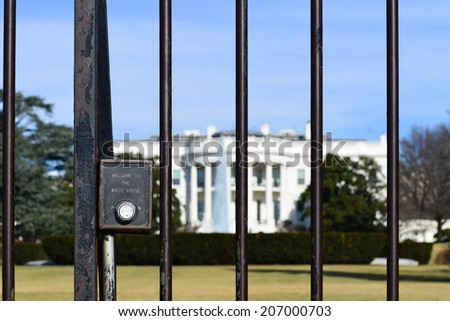 "The White House with ""Welcome to White House"" embossed fence in focus - Washington D.C. United States - stock photo"