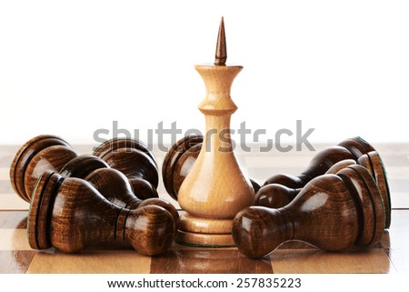 The White King and black pawns isolated - stock photo