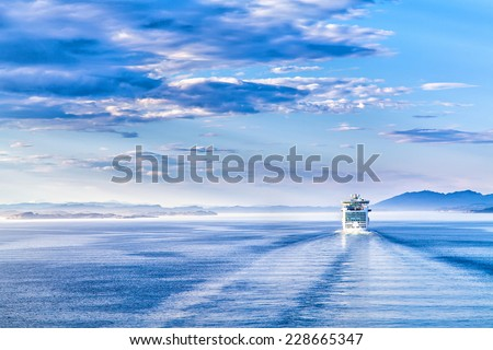 The white liner sailing on blue water - stock photo