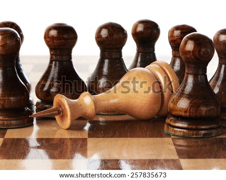 The White Queen and black pawns isolated - stock photo