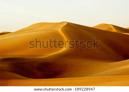 The wind shape the graceful curve of sand. - stock photo