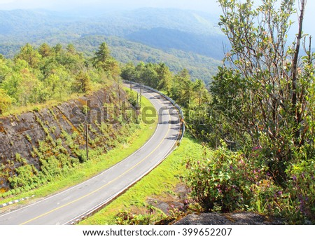 The winding roads in the hills above the beautiful mountain. - stock photo