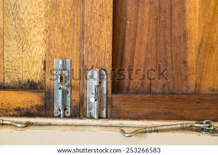 The window has two bolts - stock photo