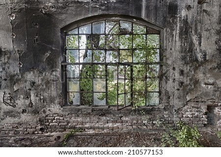 The  window in an abandoned, ruined factory - stock photo