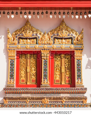The window of church of buddhism ,Wat Phra That Choeng Chum, decorate Thai style - stock photo