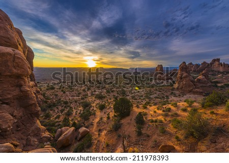 The Windows Section light up  by the rising sun Arches National Park Utah - stock photo