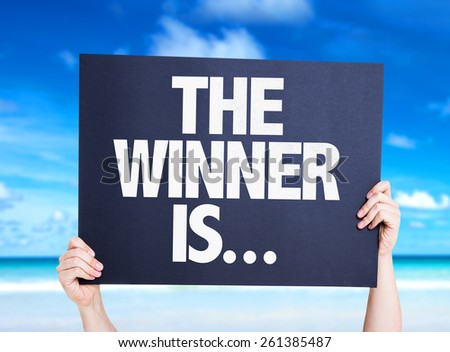 The Winner Is... card with beach background - stock photo