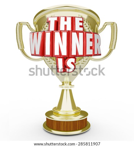 The Winner Is words in red 3d letters on a gold trophy or prize for the top performer in a competition or contest - stock photo