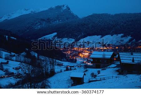 The winter Alpine landscape in the night - stock photo