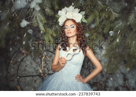 The woman closed her eyes and dreams in the hands of her mask, she was in the woods. - stock photo