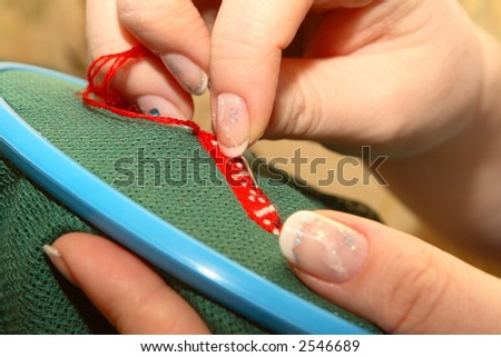 The woman embroiders with a dagger - stock photo