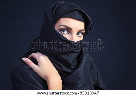 The  woman in a black coverlet. - stock photo