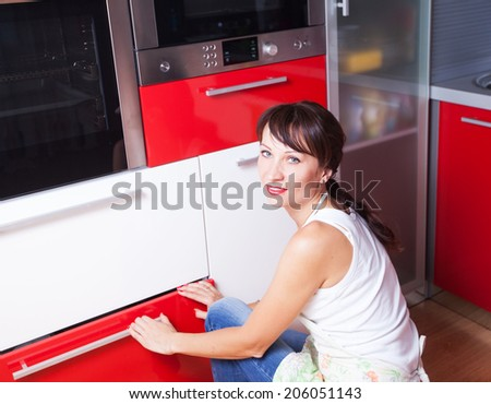 the woman in the kitchen the microwave oven - stock photo