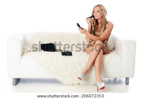 The woman in white dress on sofa - stock photo
