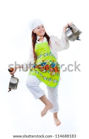 the woman isolated on white executes dance with pans - stock photo