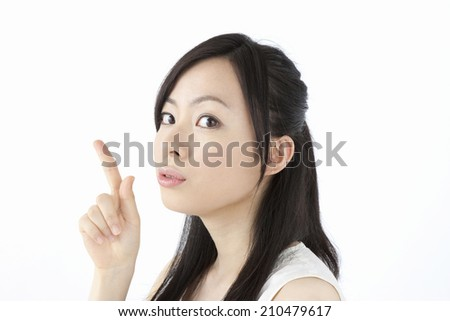 The woman reaching her index finger - stock photo