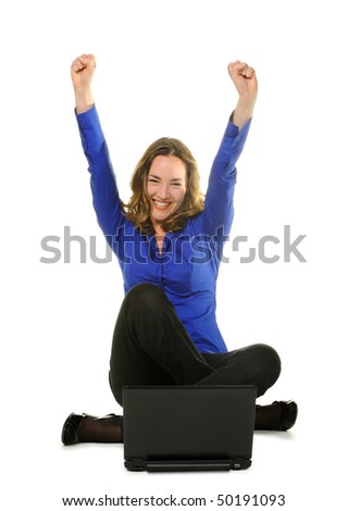 The woman sits before laptop. Emotional expression success - stock photo