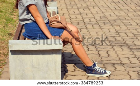 The woman sitting on the beach  - stock photo