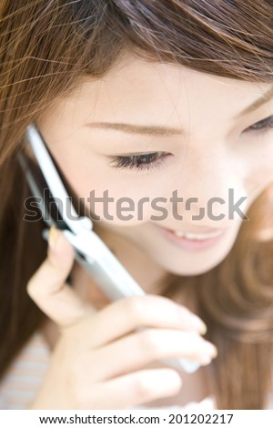 The woman talking on the mobile phone - stock photo