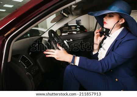 The woman  the steering wheel of the car - stock photo