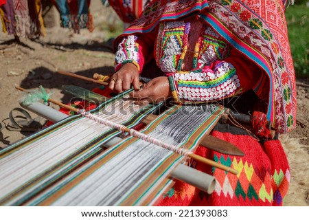 The woman weaves multi-colored fabrics, Huillos, Sacred Valley, Peru - stock photo