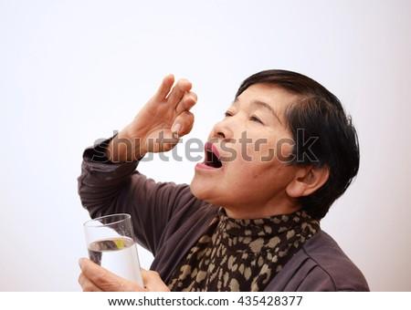 The woman who takes medicine - stock photo