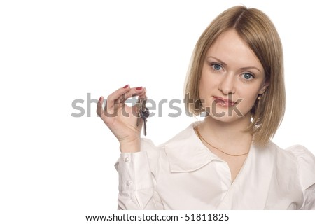 The woman with a key in a hand. - stock photo