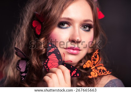 The woman with the butterflies sitting on her hair - stock photo