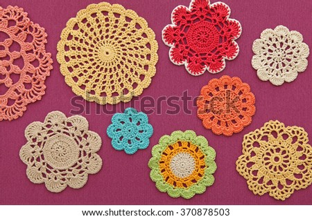 The wonderful colored crochet doilies - stock photo