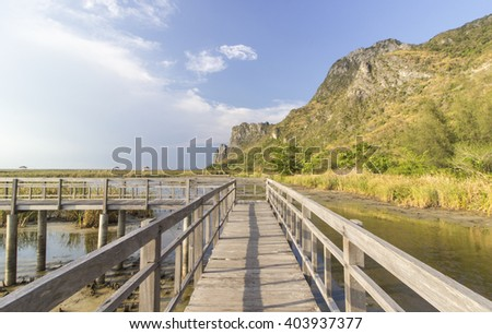The wooden bridge in the sky Bright, beautiful nature - stock photo