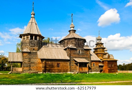 the wooden church of Ressurection and church of Transfiguration in Suzdal, Russia - stock photo