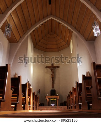 the wooden church with cross on the wall - stock photo