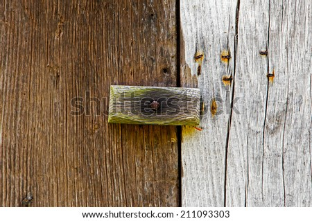 The wooden latch on a wooden door - stock photo