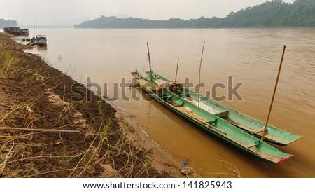 The wooden long tail boats at Mekong river in Luang Phabang, Laos. - stock photo