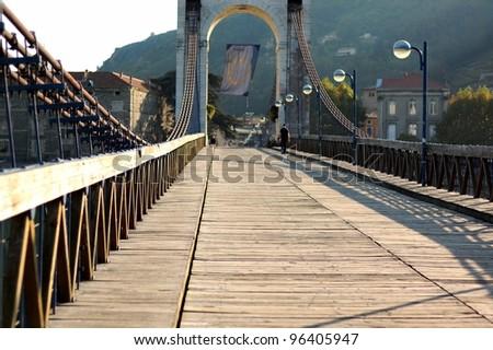 The wooden pedestrian bridge in Tain, France - stock photo