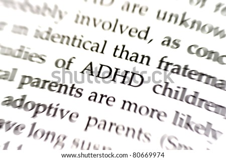 the word adhd in focus surrounded by blurred words - stock photo