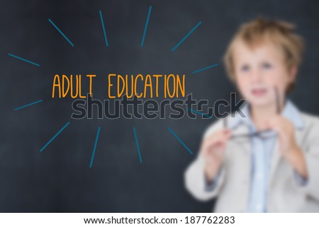 The word adult education against schoolboy and blackboard - stock photo