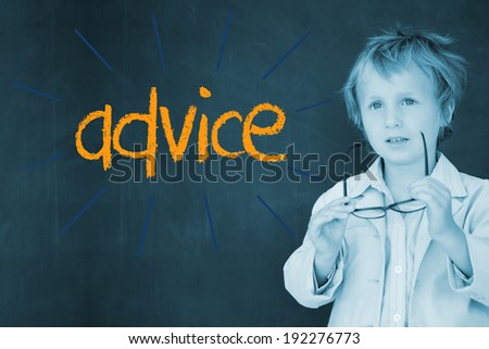 The word advice against schoolboy and blackboard - stock photo