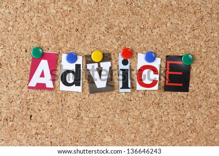 The word Advice in cut out magazine letters pinned to a cork notice board - stock photo