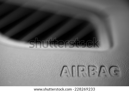"The word ""Airbag"" is written inside a car. - stock photo"