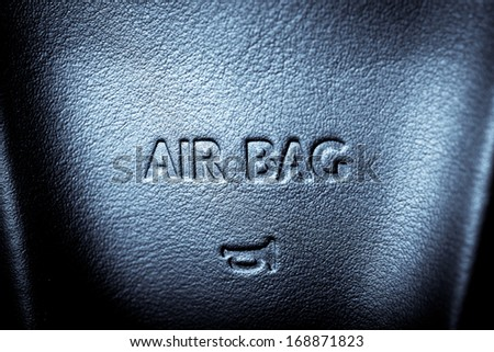 "The word ""Airbag"" is written on a car's steering wheel - stock photo"