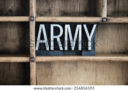 """The word """"ARMY"""" written in vintage metal letterpress type in a wooden drawer with dividers. - stock photo"""