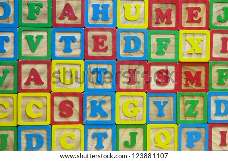 The word Autism made from toy alphabet blocks - stock photo