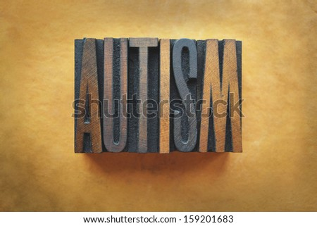 The word AUTISM written in vintage letterpress type. - stock photo