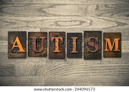 "The word ""AUTISM"" written in wooden letterpress type. - stock photo"
