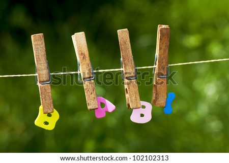 the word baby with clothes-peg on a washing line - stock photo
