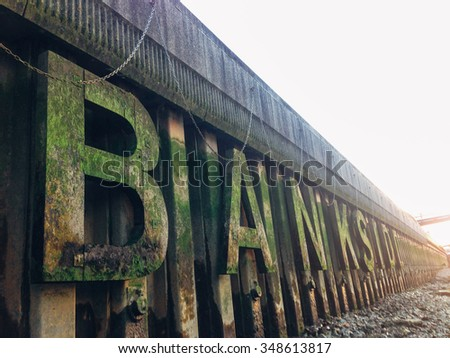 The word bankside as seen when the tide is low in river Thames in London. Gritty scenery. - stock photo