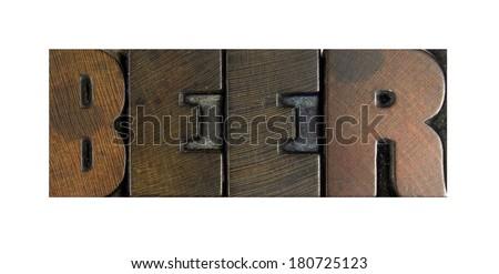 The word BEER written in vintage letterpress type - stock photo