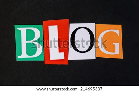 The word blog in cut out magazine letters on blackboard - stock photo